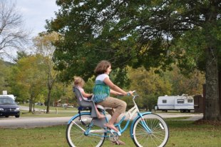 Jenah taking Naomi for a ride on the bike.