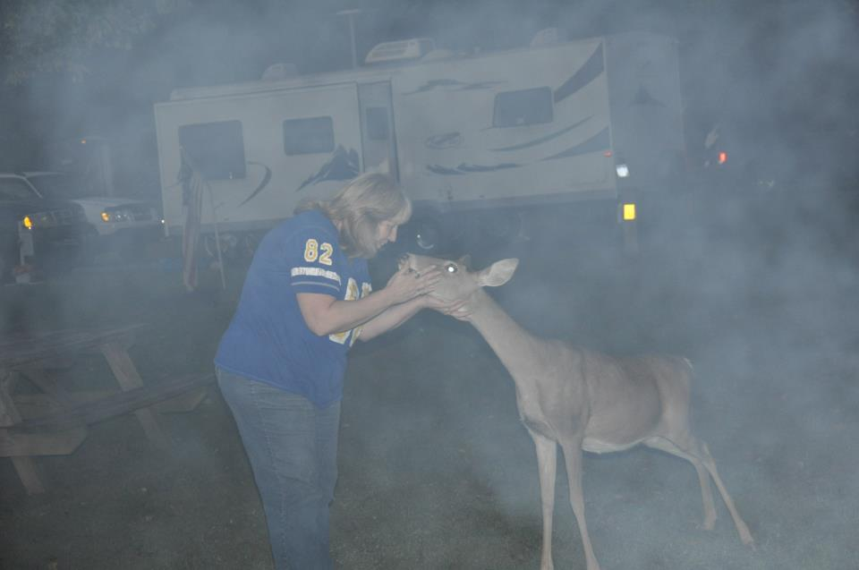 Peggy petting a friendly deer.