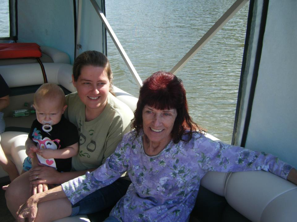 Sandy, Melissa, and Cierah enjoying the pontoon boat ride.